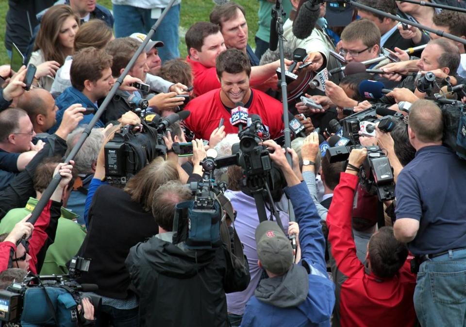 Newly-signed quarterback Tim Tebow addresses a throng of media members during the first day of Patriots minicamp Tuesday.